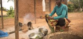 Beatrice Boakye, cocoa farmer in Ghana, preparing lunch her home.