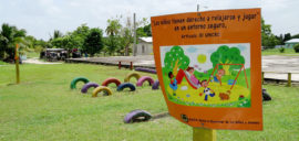 A sign at a sugar cane community in Belize reads 'Children have a right to relax and play in a safe environment'.