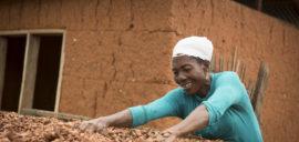 Beatrice Boakye, cocoa farmer in Ghana, drying her cocoa beans.